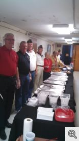 Knights Dave Johnston and Scott Krantz (from left) along with American Legion members stand ready to serve the Thanksgiving dinner.