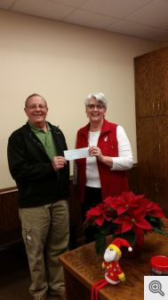 Murray Claassen presents a check to Corinne White, of Good Samaritan