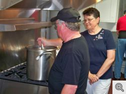 Rick Hiemenz and Rosemary Rogers in Saint Francis kitchen.