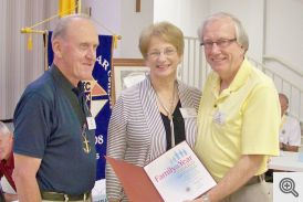 Gand Knight Bob Honzik presents ward to Carolyn and John Bodensteine