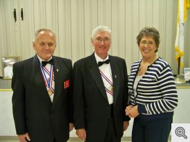 Pictured (l-r): Master of Ceremonies Bill Nosek, Event Coordinator Mike Kerwin, and Choir Direcor Lynne Border