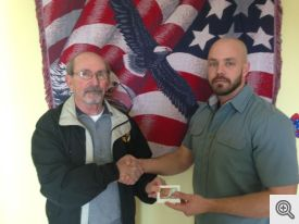 Ed Doyle presents $1,000 to ALE's Jed Johnson