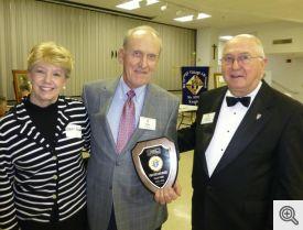 Mary Anne and Bob Honzik receiving an award from Gerald Krawczynski.