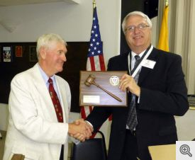 New Faithful Navigator Mike Kerwin presents a plaque to Dave Johnston for his service.