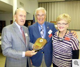 Grand Knight Bob Honzik presenting award to Milt and Janice Spaniel