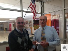 Bill Roe (l) presents a $1,000 check to Mt Pine's Paul Simms