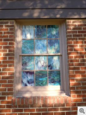 Finished window that has been caulked and glazed with the trim repaired and painted.